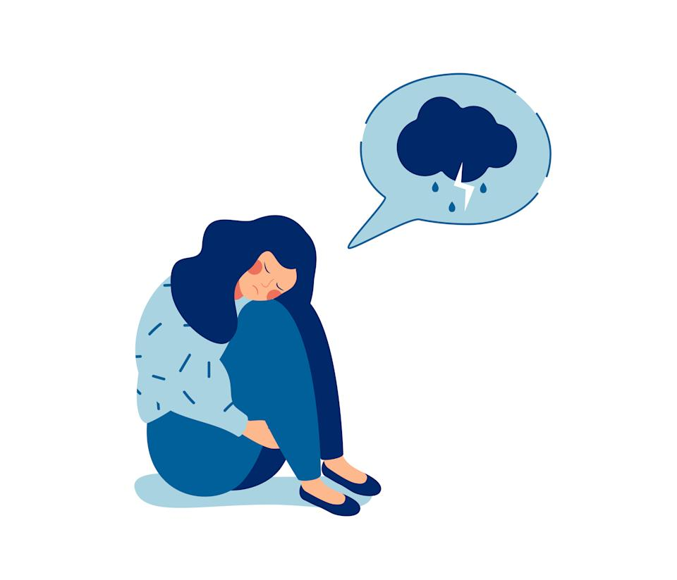 A sad girl sits, cries, hugs her knees, and cries.  A woman who is depressed and has dim thoughts in a speech bubble
