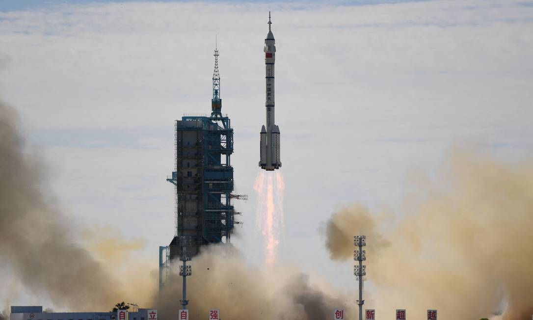 A Long March-2F rocket, carrying the Shenzhou-12 spacecraft and a crew of three astronauts, takes off from the Jiuquan Satellite Launch Center in northwest China's Gobi Desert.  It's the first mission to the country's new space station Photo: Greg Baker/AFP