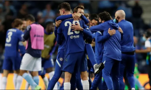 Chelsea players celebrate the Champions League title