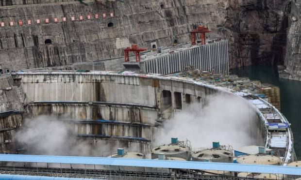 It is estimated that all units will be operational by July 2022 and generate more than 62.4 billion kilowatt-hours of electricity annually, on average Image: STR/AFP