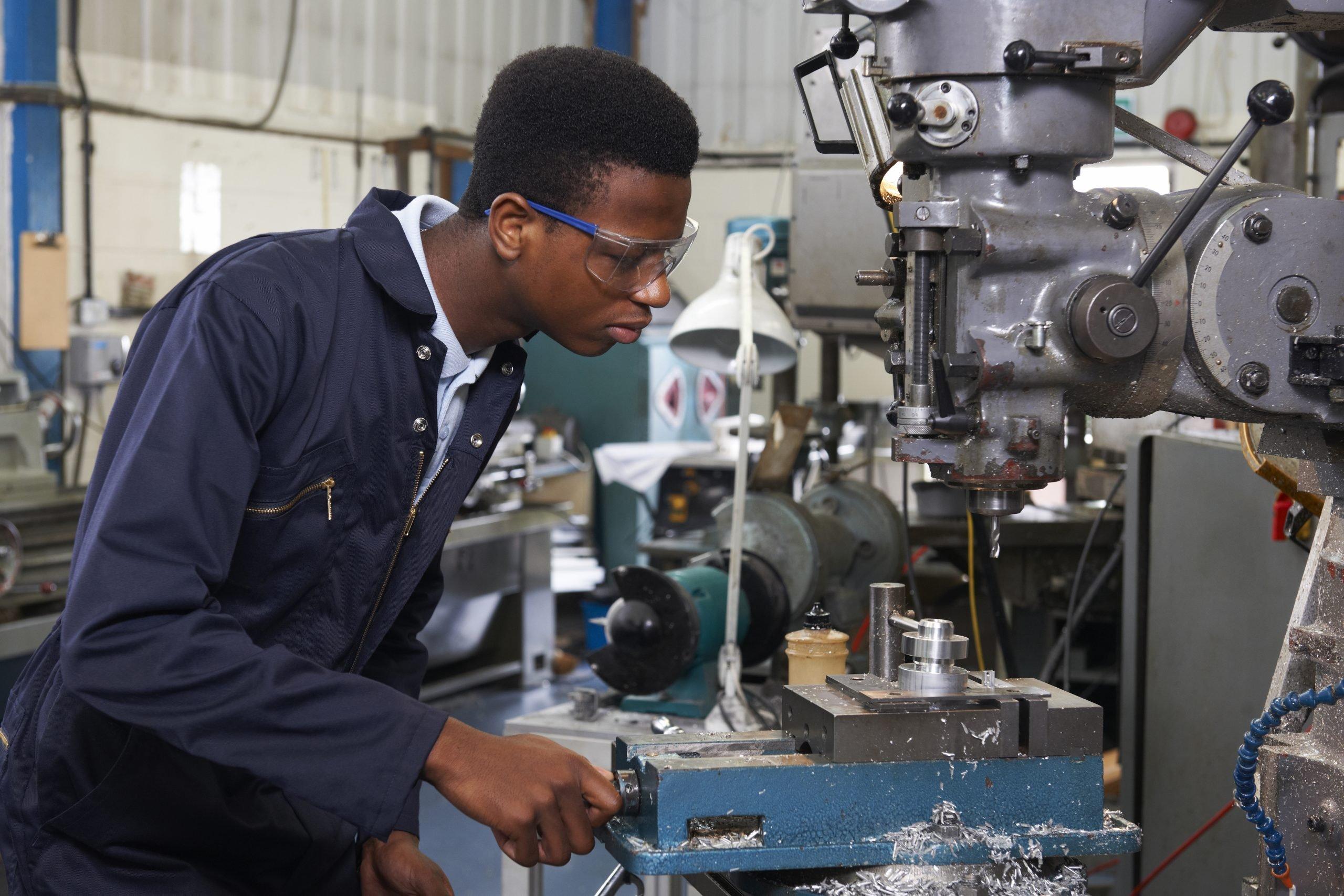 Young engineering trainee running machine