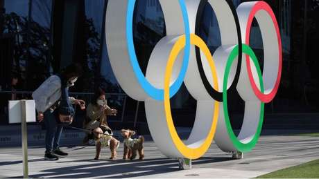 The professor says that the atmosphere in Tokyo before the opening ceremony was full of