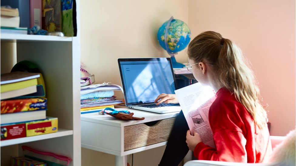 Girl taking remote class on laptop