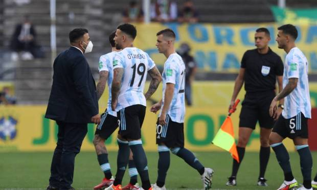 Argentine Nicolas Otamendi and his teammates leave the field after Brazilian health authorities challenge the participation of team members who have violated quarantine rules in Brazil. Photo: Amanda Perubelli/Reuters