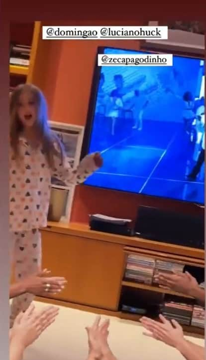Angelica shows her daughter in her giant TV room